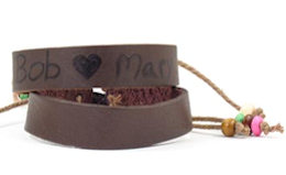 Adjustable genuine leather bracelet with ties. Personalize with Permanent marker or knife. 3/8 X 6 plus tie cords.