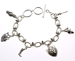 Silvertone 7 1/2 to 8 1/2 long adjustable toggle charm bracelet is ringed with 5/8 silvertone charms depicting the armor God