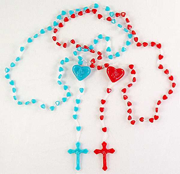 Red or blue heart shaped beads.  Sold in Packages of 24.  Philadelphia, PA Church Supply Store.